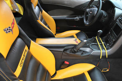 A yellow and black Corvette interior freshly detailed